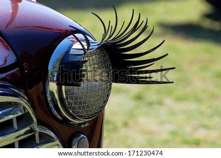 Eyelashes of old car at All British Day in Sydney AU, 25th August, 2013 The 'All British Day' is a display day featuring over 50 car clubs representing most British brands current and past.  - stock photo