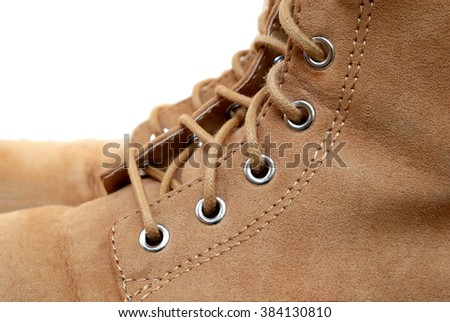 eyelets of flannel boots (isolated mode) - stock photo