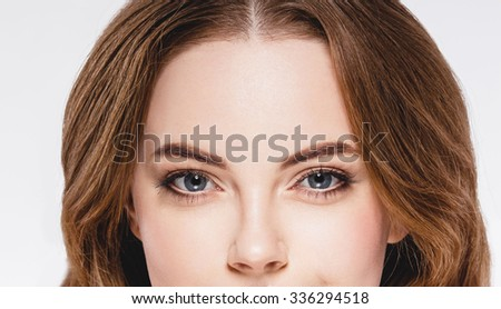 Eyes Beautiful woman face close up portrait young studio on white
