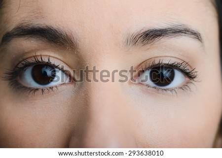 eyes close-up of a beautiful young ethnic woman with dark eyes - stock photo