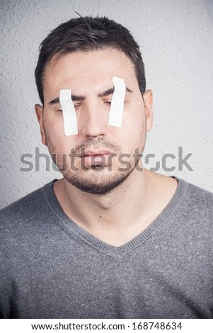 eyes covered with duct tape - stock photo