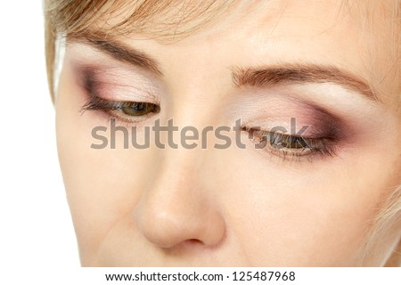 eyes makeup of mid adult woman over white