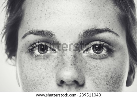 Eyes Nose freckles face woman black and white - stock photo