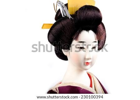 eyes of Japanese Doll white isolated - stock photo