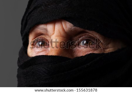 Eyes of senior muslim woman with niqab  - stock photo