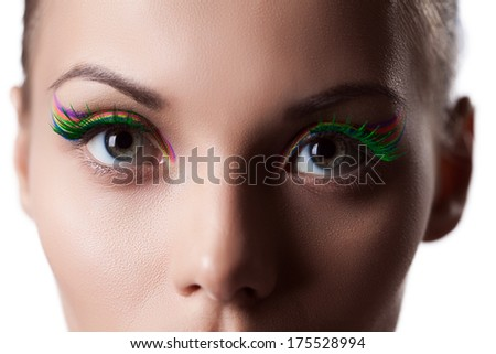 Eyes of young girl with bright makeup, close-up - stock photo