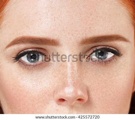 Eyes woman Young beautiful freckles woman face portrait with healthy skin - stock photo