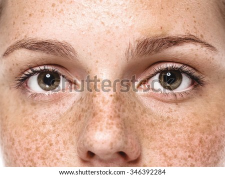 Eyes Young beautiful freckles woman face portrait with healthy skin - stock photo