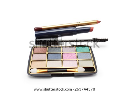 eyeshadow, brown lipstick, mascara and brown lip pencil on a white background isolated  - stock photo