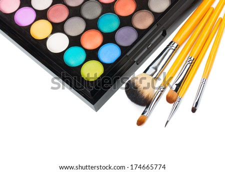 Eyeshadow makeup palette with brush isolated on white - stock photo
