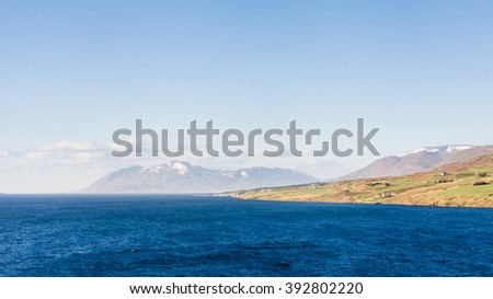 Eyjafjordur Landscape.  The view along the Northern Iceland fjord of Eyjafjordur in Northern Iceland towards the open sea.  The fjord is the longest in Iceland. - stock photo