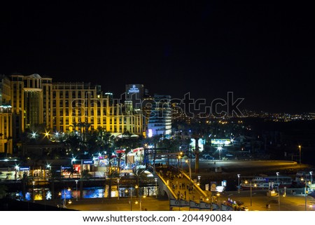 Eylat , Israel - July 06 . 2014 : View on the Aqaba gulf and Eilat city at the evening . The view from the hotel window.