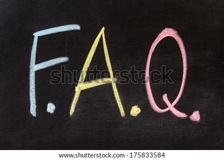 f.a.q. written with chalk on blackboard  - stock photo