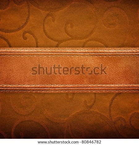 fabric background with leather strip - stock photo