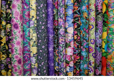 Fabric bolts - Small scale floral prints - stock photo