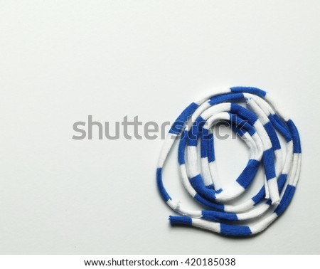 Fabric cloth rope white and blue color put on grey color background represent the rope concept related idea.