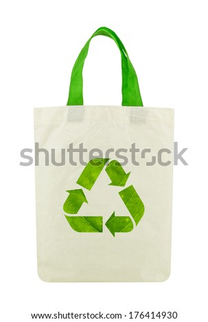 Fabric eco bag with recycle sign icon made of green leaf, Isolated on a white background. Green eco energy concept. - stock photo