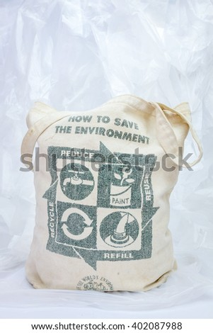 Fabric eco bag with recycle sign on plastic trash.  environmental concept. - stock photo