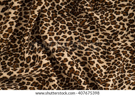 Fabric knitted with a pattern leopard. Texture, background - stock photo