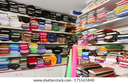 fabric rolls, many colors assortment - stock photo