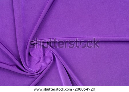 fabric silk texture. background. purpler. a fine, strong, soft, lustrous fiber produced by silkworms in making cocoons and collected to make thread and fabric. - stock photo