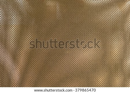 Fabric Texture, Close Up of Bronze Polyester Nylon of Office Chair to Created A Textured Background.
