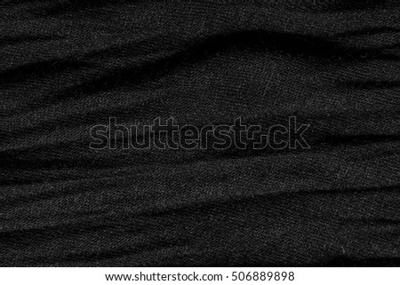 Fabric texture of crumpled black cloth. Background