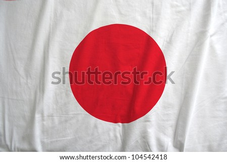 Fabric texture of the flag of Japan - stock photo