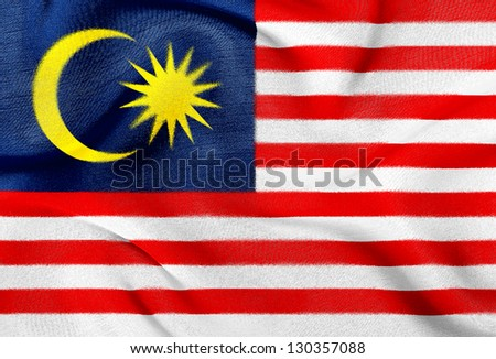 Fabric texture of the flag of Malaysia - stock photo