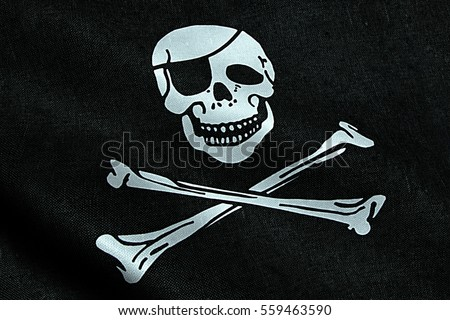 fabric texture of the pirate flag waving in wind, calico jack pirate symbol, hacker and robber concept