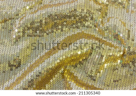 fabric texture with reflective gold rings with pleats - stock photo