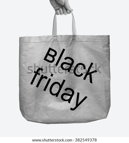 Fabric tote gray bag - black friday - with handle isolated on white background. male hand holding paper bag - stock photo
