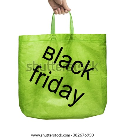 Fabric tote green bag - black friday - with handle isolated on white background. male hand holding paper bag - stock photo