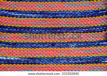 Fabric with colorful pattern, background and texture - stock photo
