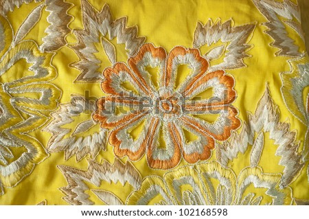 Fabric with floral embroidery - stock photo