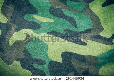 Fabrics with camouflage pattern. Background. Toned. - stock photo