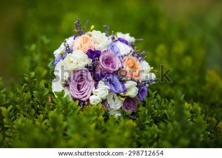 fabulous glamorous gorgeous beautiful bouquet of white and purple flowers, outdoor, green bush, design, Lviv - stock photo