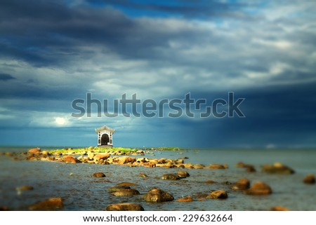 fabulous house stands on an island in the sea. rocks into the sea. scenic spots in Europe - stock photo