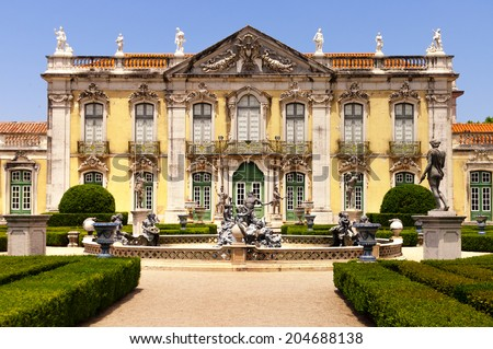 Facade and garden of Queluz National Palace with Neptune's fountain, in Sintra, Lisbon district, Portugal