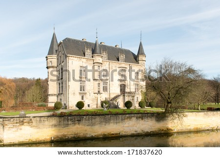 Facade and garden of Schaloen Castle in Old Valkenburg, The Netherlands - stock photo