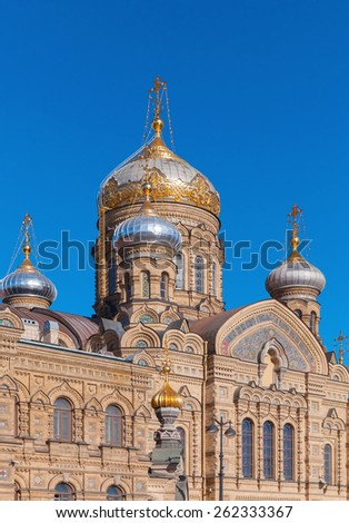 Facade and golden domes of Assumption Church on Vasilevsky Island. Orthodox church in Saint-Petersburg, Russia