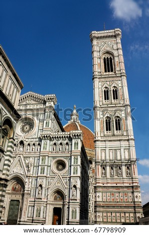 Facade, Campanile and cupola of Il Duomo in Florence, Italy.  Behind, the magnificent dome of Brunelleschi. Italy