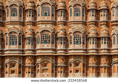 Facade exterior of highly decorated Hawa Mahal (Wind Palace) in Jaipur Rajasthan India during daytime - stock photo