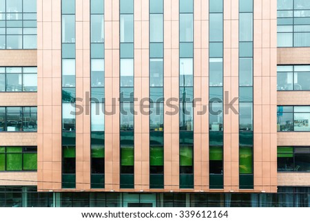 facade modern office building with transparent glass wall - stock photo