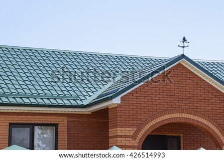 Roofing building for Metal roof pictures brick house