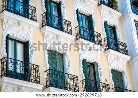 Facade of a building with balconies in Spain - stock photo