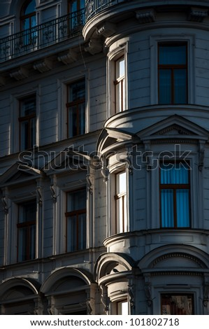 Facade of a building with many windows - stock photo