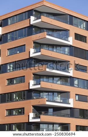 Facade of a contemporary apartment building - stock photo