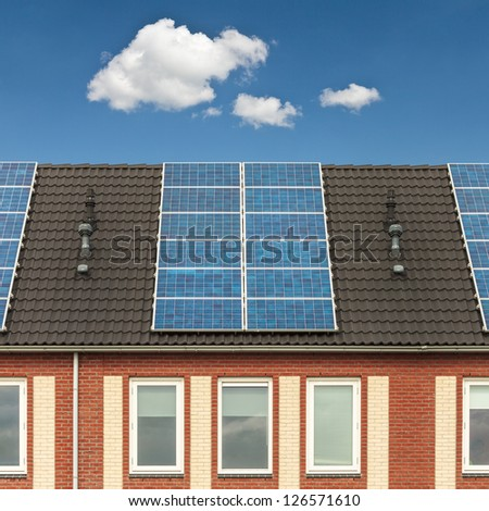 Facade of a Dutch row of new houses with solar panels - stock photo
