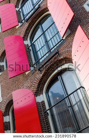 facade of a historical building in Amsterdam, Netherlands - stock photo